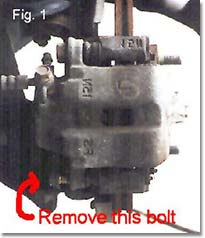 Figure 1. Remove lower bolt on caliper.