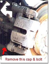 Figure 4. Remove lower cap and blot on rear caliper.